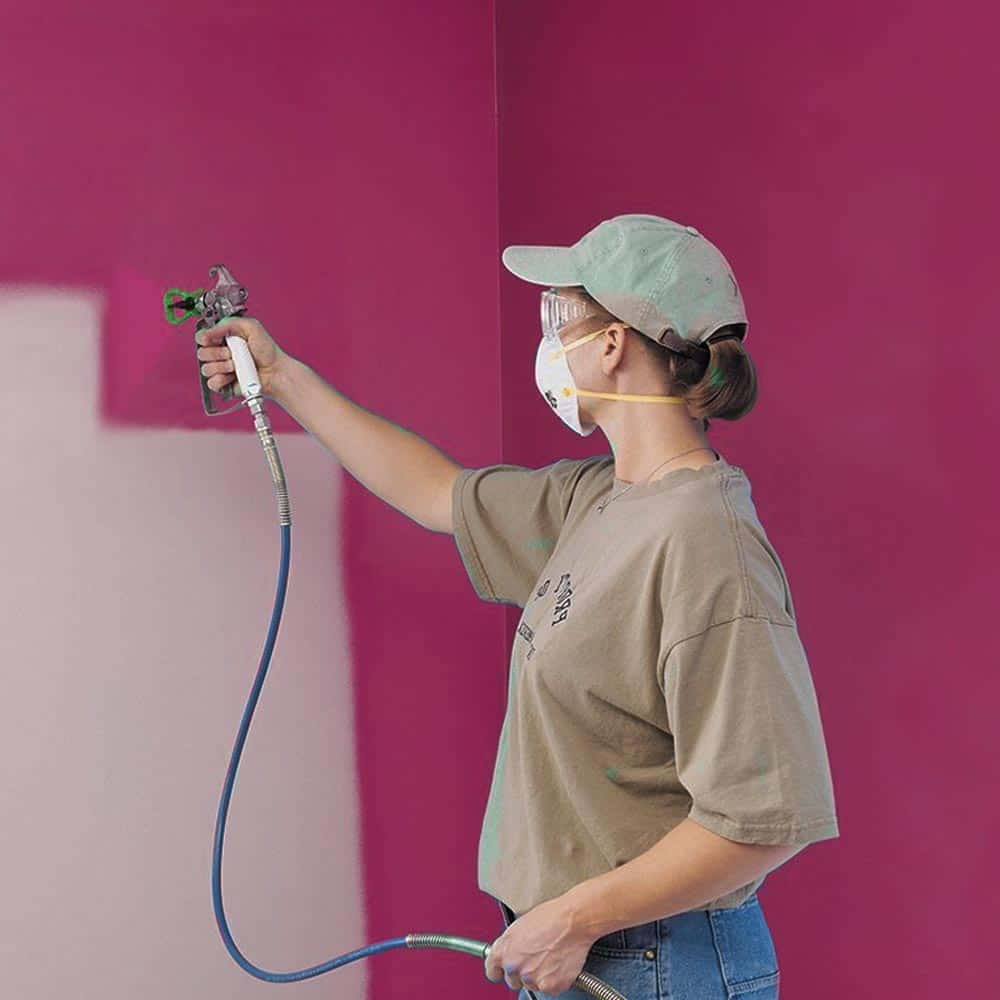 Painting interior walls with a Graco airless sprayer