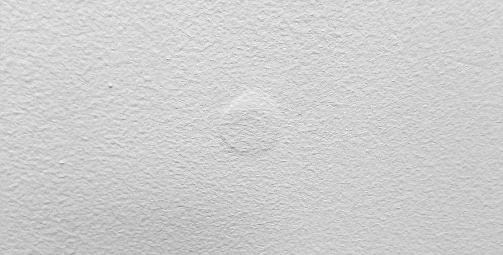 Marks Left by Spackle on Wall